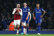 Aaron Ramsey of Arsenal celebrates after scoring his sides third goal as Theo Walcott of Everton looks dejected during the Premier League match between Arsenal and Everton at Emirates Stadium on February 3, 2018 in London, England.