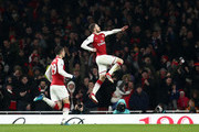 Aaron Ramsey of Arsenal celebrates after scoring his sides first goal  during the Premier League match between Arsenal and Everton at Emirates Stadium on February 3, 2018 in London, England.
