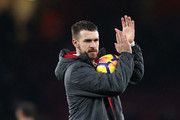 Aaron Ramsey of Arsenal shows appreciation to the fans after the Premier League match between Arsenal and Everton at Emirates Stadium on February 3, 2018 in London, England.