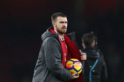 Hat-trick scorer Aaron Ramsey of Arsenal with the match ball after the Premier League match between Arsenal and Everton at Emirates Stadium on February 3, 2018 in London, England.