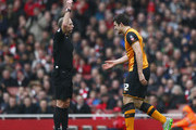Harry Maguire of Hull City is shown a yellow card by referee Mike Dean during the Emirates FA Cup fifth round match between Arsenal and Hull City at the Emirates Stadium on February 20, 2016 in London, England.