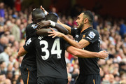 Mohamed Diame of Hull City celebrates with team-mate Hatem Ben Arfa and Ahmed Elmohamady after scoring their first goal during the Barclays Premier League match between Arsenal and Hull City at Emirates Stadium on October 18, 2014 in London, England.