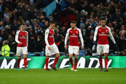 Granit Xhaka, Laurent Koscielny, Aaron Ramsey and Pierre-Emerick Aubameyang of Arsenal look dejected during the Carabao Cup Final between Arsenal and Manchester City at Wembley Stadium on February 25, 2018 in London, England.