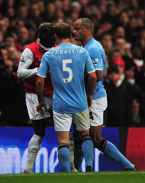 Pablo Zabaleta of Manchester City (5) and Bacary Sagna of Arsenal (L) clash as Vincent Kompany of Manchester City looks on during the Barclays Premier League match between Arsenal and Manchester City at the Emirates Stadium on January 5, 2011 in London, England. Zabaleta and Sagna are both then sent off.
