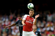 Fernandinho of Manchester City and Aaron Ramsey of Arsenal battle for the header during the Premier League match between Arsenal FC and Manchester City at Emirates Stadium on August 12, 2018 in London, United Kingdom.