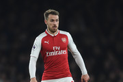 Aaron Ramsey of Arsenal runs with the ball during the Premier League match between Arsenal and Manchester United at Emirates Stadium on December 2, 2017 in London, England.