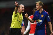 Referee Mike Dean talks to Darren Fletcher of Manchester United during the Barclays Premier League match between Arsenal and Manchester United at Emirates Stadium on November 22, 2014 in London, England.