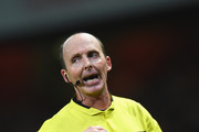 Referee Mike Dean during the Barclays Premier League match between Arsenal and Manchester United at Emirates Stadium on November 22, 2014 in London, England.
