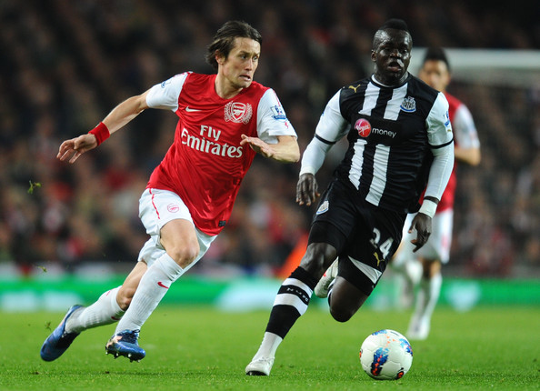 Tomas Rosicky of Arsenal and Cheik Ismael Tiote of Newcastle battle for the ball during the Barclays Premier League match between Arsenal and Newcastle United at Emirates Stadium on March 12, 2012 in London, England.