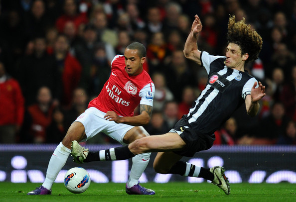 Fabrizio Coloccini of Newcastle goes in for the tackle on Theo Walcott of Arsenal during the Barclays Premier League match between Arsenal and Newcastle United at Emirates Stadium on March 12, 2012 in London, England.