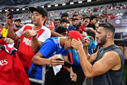 Aaron Ramsey #8 of Arsenal autographs ahead of the International Champions Cup 2018 match between Arsenal v Paris Saint Germain on July 27, 2018 in Singapore.