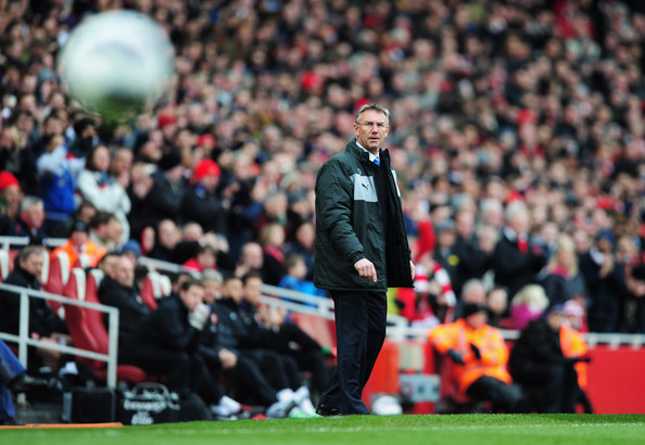 Nigel Adkins manager of Reading looks on during the Barclays Premier League match between Arsenal and Reading at Emirates Stadium on March 30, 2013 in London, England.