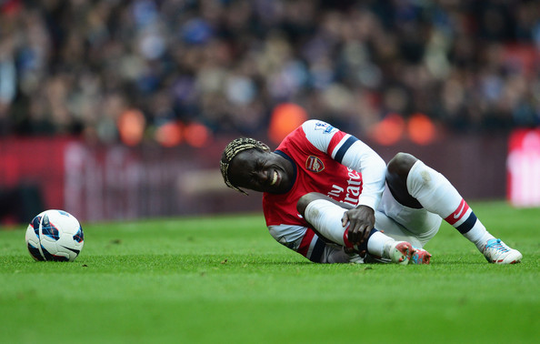 Bacary Sagna of Arsenal is injured during the Barclays Premier League match between Arsenal and Reading at Emirates Stadium on March 30, 2013 in London, England.