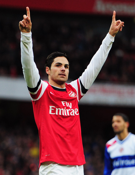 Mikel Arteta of Arsenal celebrates as he scores their fourth goal from the penalty spot during the Barclays Premier League match between Arsenal and Reading at Emirates Stadium on March 30, 2013 in London, England.