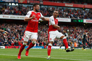 Santi Cazorla of Arsenal (R) celebrates scoring his sides second goal with Olivier Giroud of Arsenal (L) during the Premier League match between Arsenal and Southampton at Emirates Stadium on September 10, 2016 in London, England.