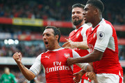 Santi Cazorla of Arsenal celebrates scoring his sides second goal with team mates  during the Premier League match between Arsenal and Southampton at Emirates Stadium on September 10, 2016 in London, England.