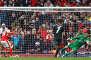 Santi Cazorla of Arsenal scores his sides first goal past Fraser Forster of Southampton during the Premier League match between Arsenal and Southampton at Emirates Stadium on September 10, 2016 in London, England.