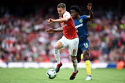 Aaron Ramsey of Arsenal and Carlos Sanchez of West Ham battle for the ball during the Premier League match between Arsenal FC and West Ham United at Emirates Stadium on August 25, 2018 in London, United Kingdom.