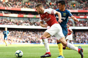 Aaron Ramsey of Arsenal is challenged by Lucas Perez of West Ham United during the Premier League match between Arsenal FC and West Ham United at Emirates Stadium on August 25, 2018 in London, United Kingdom.