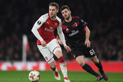 Aaron Ramsey of Arsenal runs with the ball during the UEFA Europa League Round of 16 second leg match between Arsenal and AC Milan at Emirates Stadium on March 15, 2018 in London, England.