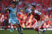 Aaron Ramsey of Arsenal gets past Ashley Westwood of Burnley during the Premier League match between Arsenal and Burnley at Emirates Stadium on May 6, 2018 in London, England.