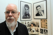 Artist Peter Blake poses for a photograph besides a some of his collection as he reopens the Holburne Museum on May 12, 2011 in Bath, England. The new museum's first exhibition  - which opens to the public on Saturday - is Peter Blake: A Museum for Myself and will for the first time show extraordinary objects from Peter Blake's own collection together with a number of important works by the artist himself. The new Holburne Museum includes the restoration of its Grade I listed building and the construction of a striking new extension by Eric Parry Architects. The Museum houses a collection of fine and decorative arts built around the remarkable art collection of Sir William  Holburne, first assembled in 19th century Bath, including works by  Gainsborough, Zoffany and Turner.