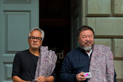 Anish Kapoor (L) and Ai Weiwei pose for members of the press at the Royal Academy ahead of their walk through the city as part of a march in solidarity with migrants currently crossing Europe on September 17, 2015 in London, England. Each artist carried a single blanket symbolizing the needs that face migrants coming to Europe.