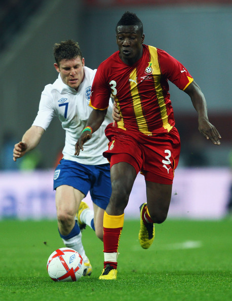 Asamoah Gyan James Milner of England (L) attempts to tackle Asamoah Gyan of Ghana during the international friendly match between England and Ghana at Wembley Stadium on March 29, 2011 in London, England.