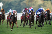 Ryan Moore riing Blue Mist (L) win The Mar-Key Group Classified Stakes at Ascot Racecourse on October 5, 2018 in Ascot, United Kingdom.