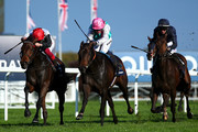 Frankie Dettori rides Star Catcher (L) to win The QIPCO British Champions Fillies & Mares Stakes during the QIPCO British Champions Day at Ascot Racecourse on October 19, 2019 in Ascot, England.