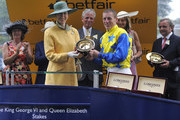 Johnny Murtagh (R) collects his winners trophy from Princess Anne, Princess Royal after riding Novellist to the win in The King George VI and Queen Elizabeth Stakes at Ascot racecourse on July 27, 2013 in Ascot, England.