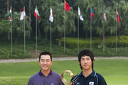 Chang-Won Han (R) and Eric Chun of South Korea pose at the end of the Asian Amateur Championship at the Mission Hills Golf Club on November 1, 2009 in Shenzhen, Guangdong, China. Chang-Won Han wins a place at the 2010 Masters Tournament and International Final Qualifying for the 150th Open Championship at St Andrews