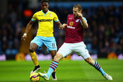 Wilfried Zaha of Crystal Palace is tackled by Ron Vlaar of Aston Villa during the Barclays Premier League match between Aston Villa and Crystal Palace at Villa Park on January 1, 2015 in Birmingham, England.
