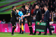 Ilkay Gundogan of Manchester City is replaced by Kevin De Bruyne during the Carabao Cup Final between Aston Villa and Manchester City at Wembley Stadium on March 01, 2020 in London, England.