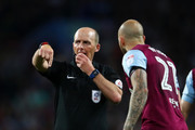 Referee Mike Dean in action during the Sky Bet Championship Play Off Semi Final second leg match between Aston Villa and Middlesbrough at Villa Park on May 15, 2018 in Birmingham, England.