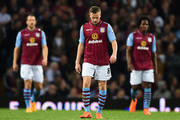 (L-R) Ron Vlaar, Tom Cleverley and Carlos Sanchez of Aston Villa look dejected as Clint Hill of QPR scores their second goal during the Barclays Premier League match between Aston Villa and Queens Park Rangers at Villa Park on April 7, 2015 in Birmingham, England.
