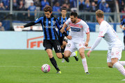 (L-R) Marten De Roon of Atalanta BC competes for the ball with Andrea Lazzari of Carpi FC during the Serie A match between Atalanta BC and Carpi FC at Stadio Atleti Azzurri d'Italia on October 18, 2015 in Bergamo, Italy.