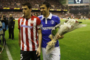 Captains Andoni Iraola (L) of Athletic Bilbao and Raul Gonzalez of FC Schalke 04 hold a  bouquet of flowers to the Pitxitxi (Pichichi) statue, before the UEFA Europa League quarter-final second leg match between Athletic Bilbao and FC Schalke 04 at San Mames Stadium on April 5, 2012 in Bilbao, Spain.