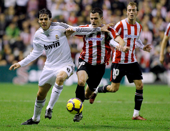 Pablo Orbaizi Kaka (L) of Real Madrid competes for the ball with Pablo Orbaiz of Athletic Bilbao during the La Liga match between Athletic Bilbao and Real Madrid at the San Mames stadium on January 16, 2010 in Bilbao, Spain.