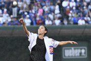 Christen Press of the U.S. Women's National Soccer Team throws out a ceremonial first pitch before the game between the Chicago Cubs and the Atlanta Braves on August 31, 2017 at Wrigley Field in Chicago, Illinois.
