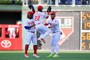 Odubel Herrera #37, Andrew McCutchen #22 and Bryce Harper #3 of the Philadelphia Phillies celebrate after beating the Atlanta Braves 10-4 on Opening Day at Citizens Bank Park on March 28, 2019 in Philadelphia, Pennsylvania.