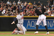 Freddie Freeman #5 of the Atlanta Braves safely steals second base in front of Ketel Marte #4 of the Arizona Diamondbacks in the tenth inning of the MLB game at Chase Field on September 8, 2018 in Phoenix, Arizona.