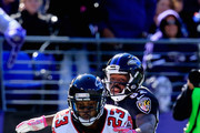 Cornerback Robert Alford #23 of the Atlanta Falcons makes a second quarter interception while battling wide receiver Torrey Smith #82 of the Baltimore Ravens at M&T Bank Stadium on October 19, 2014 in Baltimore, Maryland.