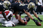 Manti Te'o #51 of the New Orleans Saints recovers a fumble during the second half of a game against the Atlanta Falcons at the Mercedes-Benz Superdome on December 24, 2017 in New Orleans, Louisiana.