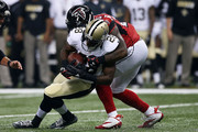 C.J. Spiller #28 of the New Orleans Saints is brought down by William Moore #25 of the Atlanta Falcons during the first quarter of a game at the Mercedes-Benz Superdome on October 15, 2015 in New Orleans, Louisiana.
