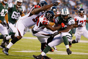 Phillip Adams #20 of the Atlanta Falcons tackles running back Chris Ivory #33 of the New York Jets during their pre season game at MetLife Stadium on August 21, 2015 in East Rutherford, New Jersey.