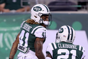 Buster Skrine #41 of the New York Jets celebrates a stop with teammate Morris Claiborne #21 in the first quarter against the Atlanta Falcons during a preseason game at MetLife Stadium on August 10, 2018 in East Rutherford, New Jersey.