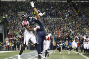 Tight end Jimmy Graham #88 of the Seattle Seahawks can't bring in a pass in the end zone against strong safety Keanu Neal #22 of the Atlanta Falcons during the game at CenturyLink Field on November 20, 2017 in Seattle, Washington.