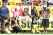 Antonio Brown #84 of the Pittsburgh Steelers celebrates after a 9 yard touchdown  reception in the second half during the game against the Atlanta Falcons at Heinz Field on October 7, 2018 in Pittsburgh, Pennsylvania.