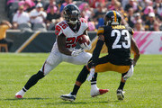 Tevin Coleman #26 of the Atlanta Falcons carries the ball against Joe Haden #23 of the Pittsburgh Steelers in the first half during the game at Heinz Field on October 7, 2018 in Pittsburgh, Pennsylvania.